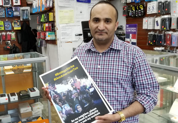 Zaid Alnagi with New York City's Yemeni-American Merchants Association delivers posters for the association's protest on Tuesday.