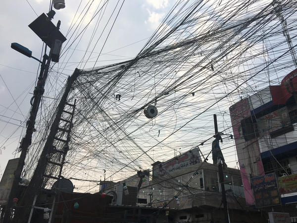 Fifteen years after the U.S. invasion, electricity is still unreliable in Baghdad. These electrical cables go to a private community generator. Residents who can afford it pay to run lines to it.