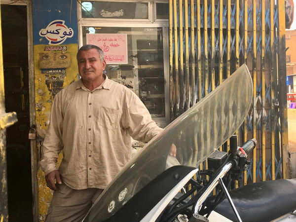 Qathem Sherif al-Jabouri at his motorcycle repair shop in Baghdad. Even though the former powerlifter spent 11 years in prison when Iraq was ruled by Saddam Hussein, he now says the country was better off in those days.