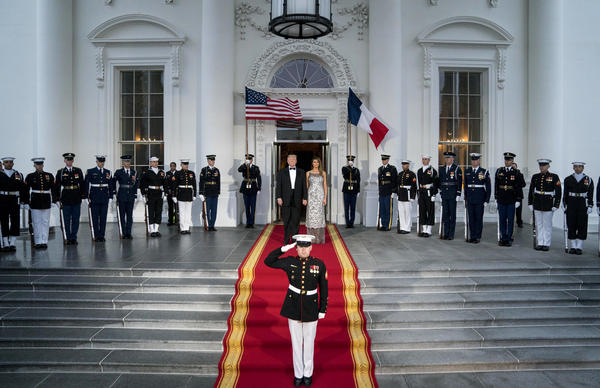 President Trump and first lady Melania Trump prepare to greet French President Emmanuel Macron and his wife, Brigitte Macron, as they arrive for a state dinner at the White House on Tuesday.
