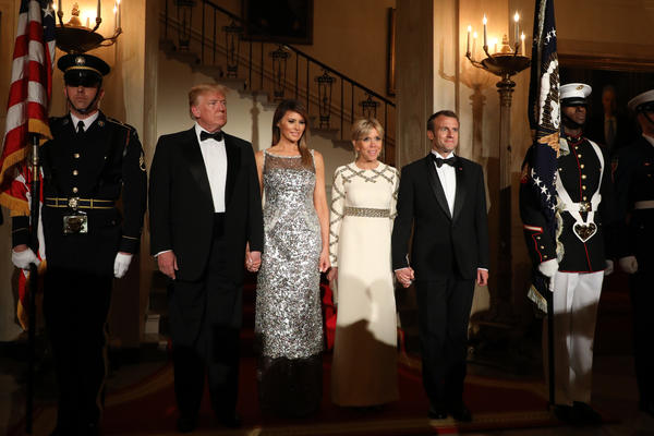 The Trumps and Macrons arrive for the state dinner.