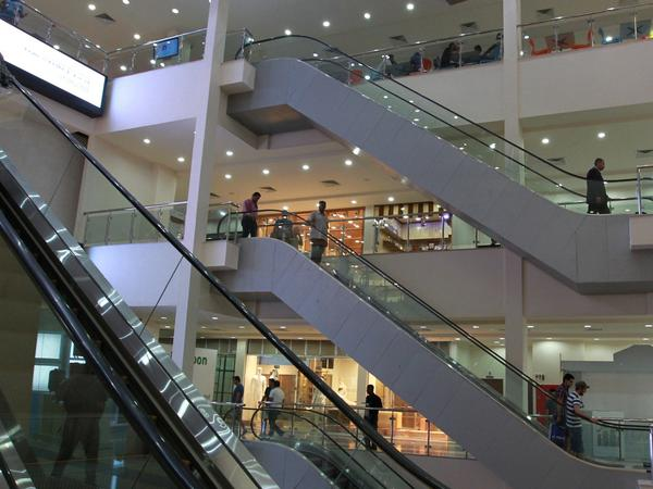 """Iraqis visit Baghdad's Al-Nakheel """"Palm"""" Mall in 2015. Despite damage in the city going back to 2003, gleaming shopping malls have opened in recent years."""