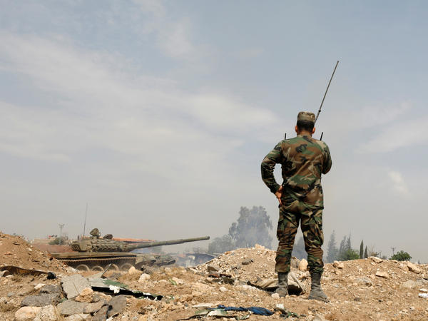 A soldier in Syria's President Bashar al-Assad forces near the Yarmouk Palestinian camp in Damascus. Syria's government captured at least two villages from U.S.-backed Syrian Democratic Forces east of the Euphrates River near the border with Iraq.