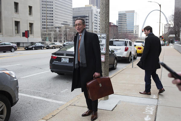 Attorney Al Watkins speaks with reporters outside the Carnahan Courthouse in downtown St. Louis following a hearing on March 26.