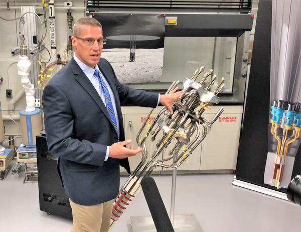 Lead engineer Marc Gibson points to the hardware inside NASA's new Kilopower nuclear power system. The unit can generate up to 10 kilowatts of power continuously over decades with minimal maintenance.