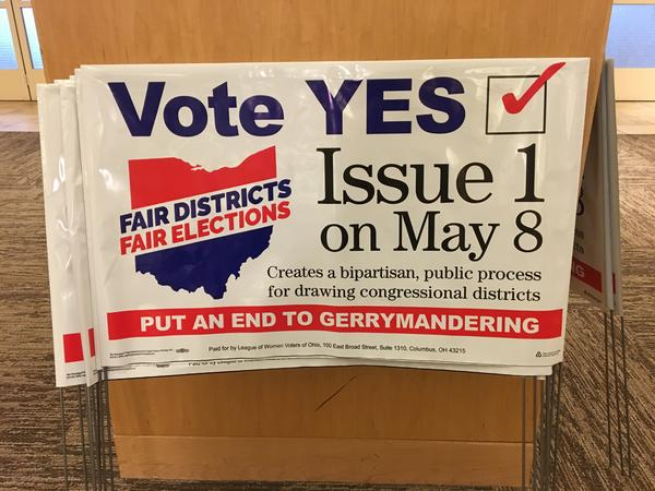 Supporters of Issue 1 distributed yard signs at a City Club of Cleveland event on April 26.