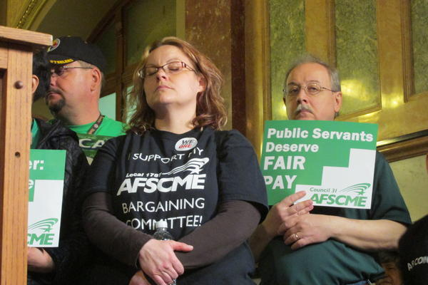 Leslie Alfred, left, waits to address a crowd of Illinois AFSCME members at an April 26 Statehouse rally