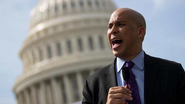 Sen. Cory Booker, D-N.J., has released plan that would create pilot job guarantee programs in 15 communities where unemployment is particularly high.