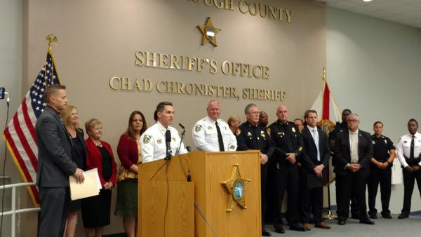 Hillsborough County Sheriff Chad Chronister is flanked by Hillsborough School officials and board members, along with deputies from the School District and other law enforcement officials, at a Thursday press conference in Tampa.