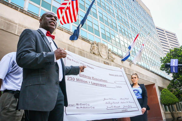 The Rev. Gregory Manning speaks during a news conference at City Hall on Thursday. Opponents of the plant are calling on City Council to rescind its approval.