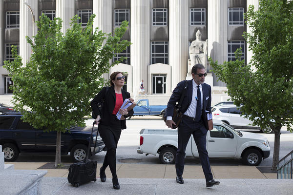 Michelle Nasser and Scott Rosenblum, members of Missouri Gov. Eric Greitens' defense team, arrive at the St. Louis Civil Courts building Thursday morning for the first day of jury selection in Greitens' felony invasion of privacy trial.