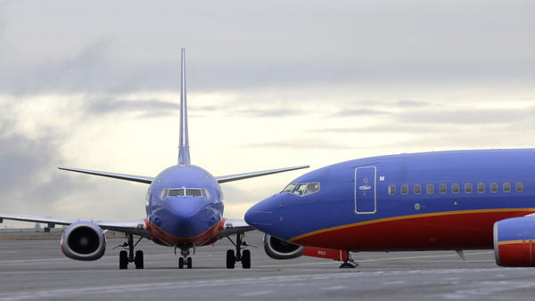"""Southwest Airlines says that the crew of a Dallas-bound flight """"radioed ahead for paramedics to meet the aircraft after a pressurization issue in flight"""" Here, a Southwest Airlines plane waits to taxi, in a file photo."""
