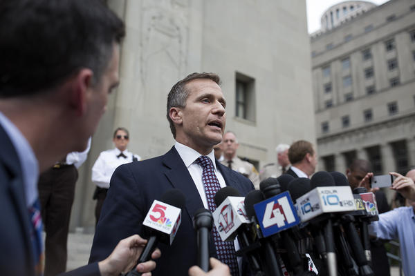 Governor Eric Greitens speaks to reporters outside the Civil Courts Building in downtown St. Louis after his felony invasion of privacy charge was dropped.