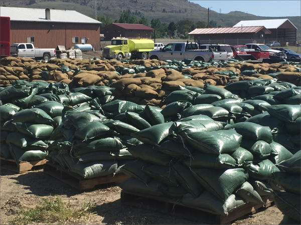 Thousands of sand bags are being shipped to locations throughout the Okanogan Valley as crews prepare for major flooding.