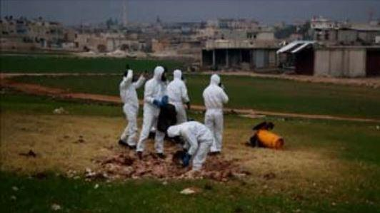 A team samples the impact site of a cylinder that contained chlorine gas, which was dropped on a field in the rebel-held Syrian city of Saraqeb on Feb. 4.