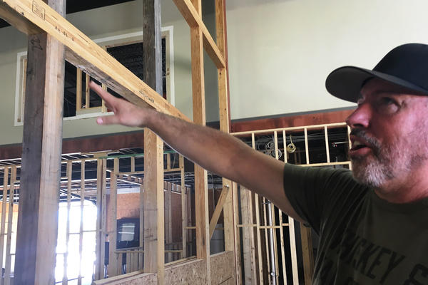 Military retiree Scott Neil is overseeing construction of his new distillery in Florida. He decided to retire in the state in part because of its programs for veterans and retirees.