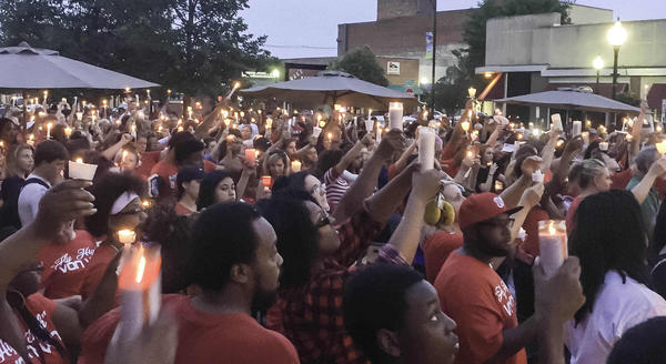 Hundreds of people in Danville gather for a candlelight vigil on June 13, 2016, in honor of Devon McClyde, who was shot while playing basketball in Garfield Park on June 8, 2016. In 2017, eight people were killed from gun violence in Danville.