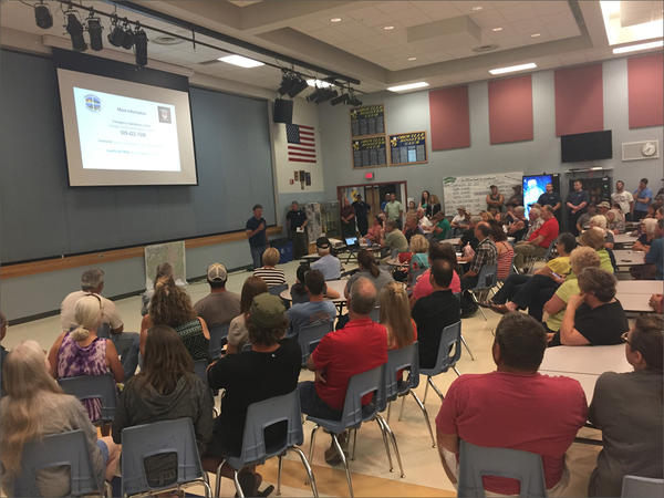 Roughly 200 people attended a public meeting at the high school in Oroville. They were briefed by emergency managers on flooding in the Okanogan Valley.