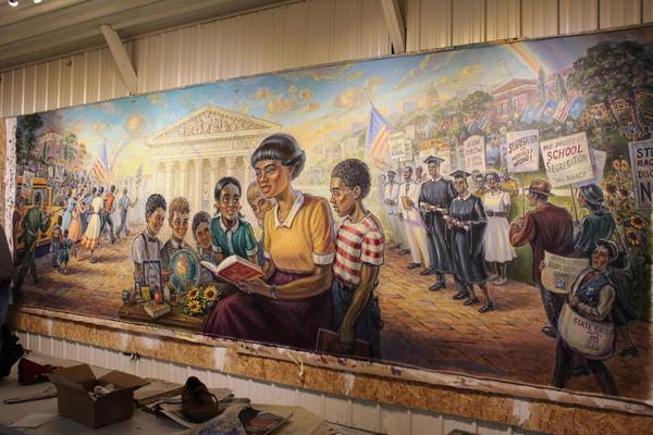 The Brown v. Board mural stands nearly complete in artist Michael Young's studio. The mural is now on display on the 3rd floor of the Kansas Capitol.