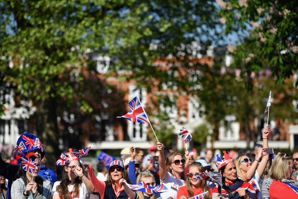 Thousands of people wait for hours outside Windsor Castle to celebrate Prince Harry and Meghan Markle's wedding on Saturday in Windsor, England.