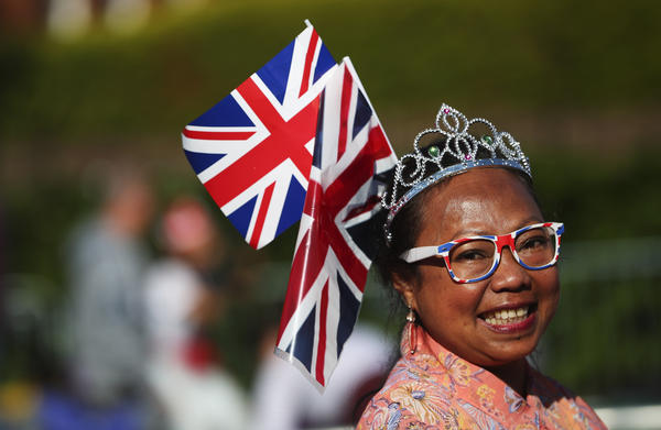 Many of the onlookers at Windsor Castle show their national pride as well as their royal appreciation.
