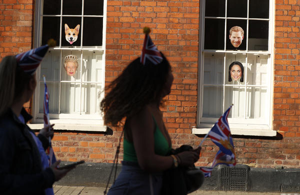 Royal images — including those of Prince Harry, Meghan Markle, Queen Elizabeth II and of course, the well-known royal pets, a corgi — abound in Windsor on Saturday.