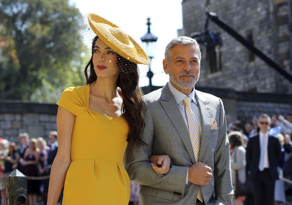 The crowd cheered when human rights lawyer Amal Clooney and actor George Clooney headed to St. George's Chapel for the ceremony.