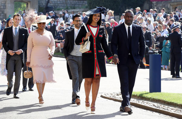 Actor Idris Elba and fiancee Sabrina Dhowre, followed by Oprah Winfrey, walk to St. George's Chapel in Windsor, England.