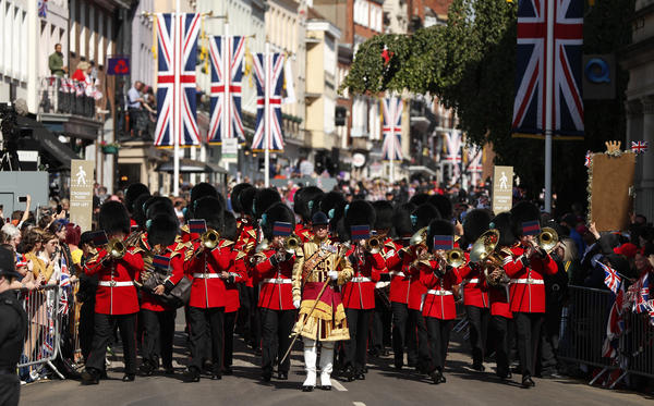 A marching band performs on the streets of Windsor under sunny skies ahead of the royal nuptials.