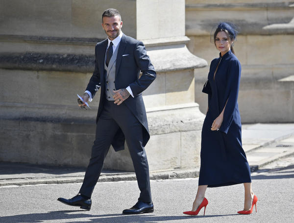 David and Victoria Beckham arrive for the ceremony at Windsor Castle. They had also attended the wedding of Prince William and Kate, Duke and Duchess of Cambridge, seven years ago.