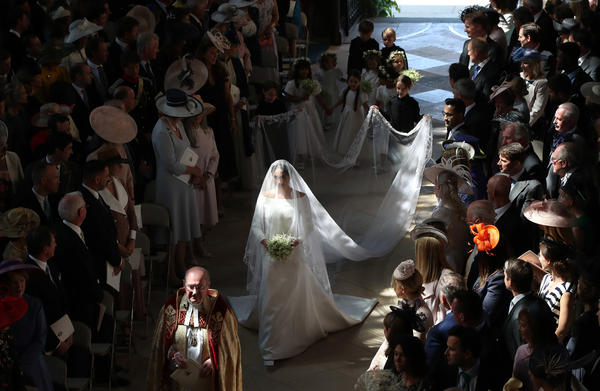In a dress by British designer Clare Waight Keller, Meghan walks herself partway down the aisle (she was joined by Prince Charles for the final stretch).