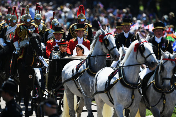 The carriage was pulled by four Windsor grey horses — Milford Haven, Sir Basil, Tyrone and Storm.