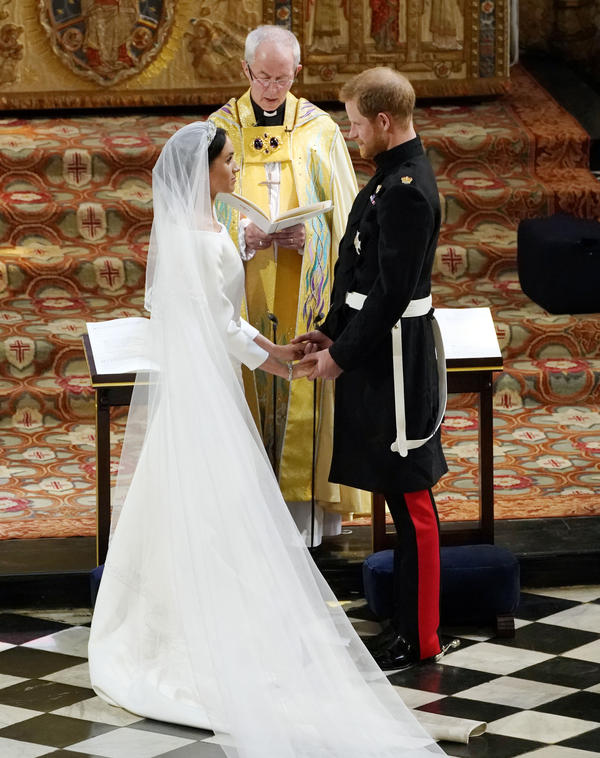 Archbishop of Canterbury Justin Welby officiates at Harry and Meghan's wedding. The service followed Common Worship, the official series of services associated with the Church of England.