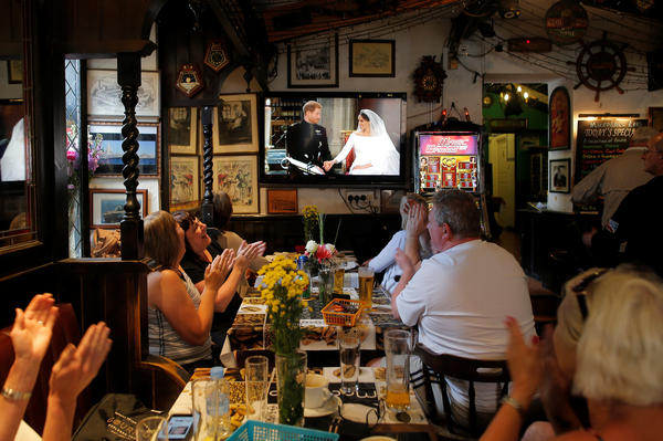 In the British overseas territory of Gibraltar, tourists gather at a restaurant to celebrate the royal wedding.
