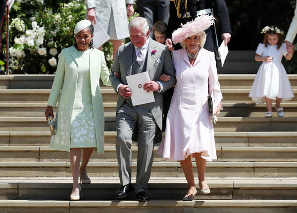 Prince Charles, father of the groom, accompanies Doria Ragland (left), mother of the bride, and his wife, Camilla, Duchess of Cornwall, down the steps at Windsor Castle.
