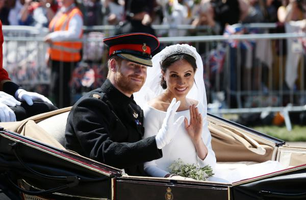 Harry and Meghan wave to the crowd outside Windsor Castle. Many of them had waited hours for a good spot to celebrate the royal couple.