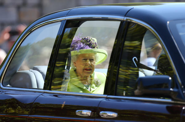 Queen Elizabeth II arrives at St George's Chapel for her grandson's wedding. She was joined by her husband, Prince Philip, who recently underwent surgery.