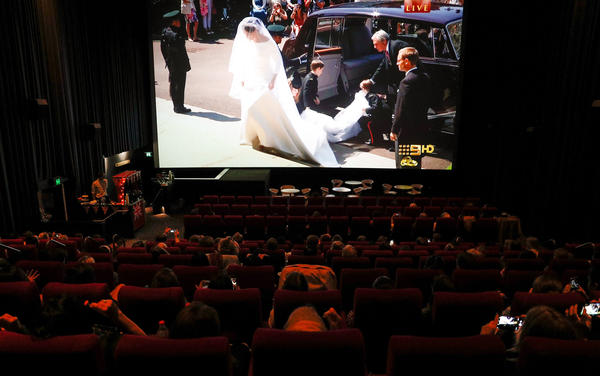 The wedding was truly a global affair. In Australia, spectators watch the celebration at George Street Event Cinemas in Sydney.