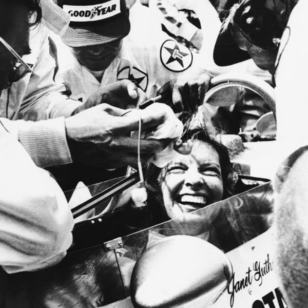 Janet Guthrie is all smiles as her pit crew swarms around her following the 62nd running of the Indianapolis 500 auto race in 1978 in Indianapolis, Ind.