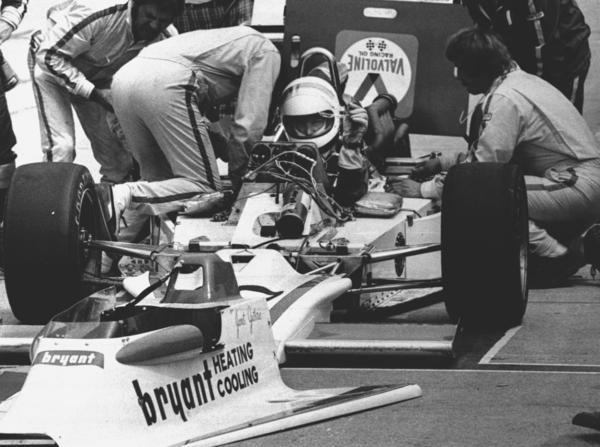 """Janet Guthrie and her pit crew at the Indianapolis 500 in 1977, her first. She tells NPR that while racing, her engine began """"popping and banging"""" and could not be fixed. She finished 29th. She qualified and raced in two more Indy 500 races."""
