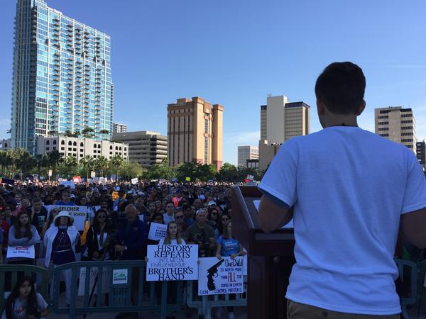 Sam Sharf, a 17-year-old junior at Plant High School, addresses the large crowd at the march at Curtis Hixon Park in Tampa.