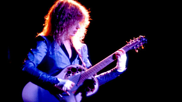 Heart's Nancy Wilson onstage in 1983, looking very Jimmy Page.