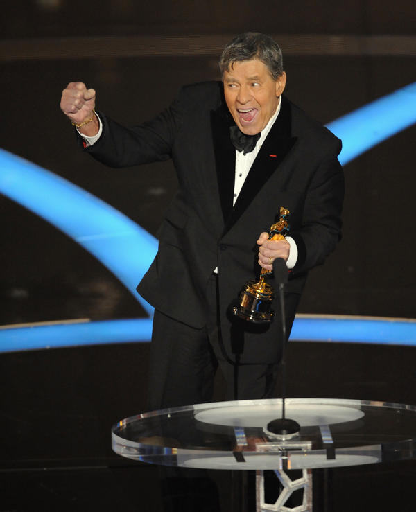Lewis accepts the Jean Hersholt Humanitarian Award during the Oscars in 2009.