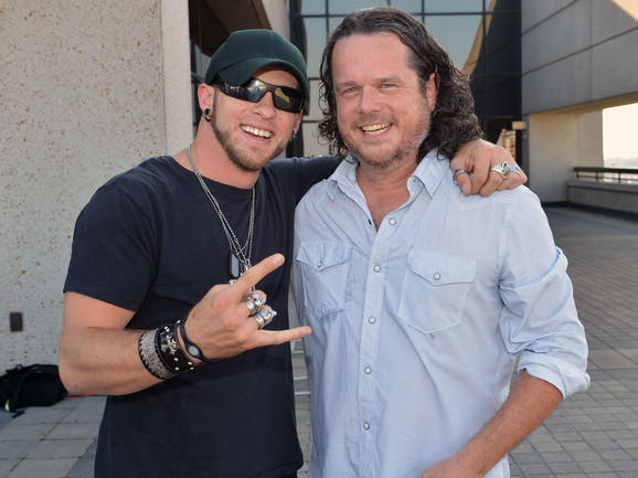 """McCormick (right) with singer-songwriter Brantley Gilbert. Gilbert's song """"You Don't Know Her Like I Do,"""" which McCormick co-wrote, hit the top of <em>Billboard</em>'s Hot Country Songs chart in the summer of 2012."""