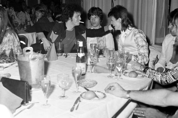 Reed, Mick Jagger and David Bowie share a joke at a party at Cafe Royal thrown by Bowie in 1973.