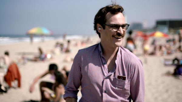 Beautiful Music Together: Joaquin Phoenix takes a walk on the beach with his girlfriend the Operating System in the Oscar-nominated film<em> Her</em>.