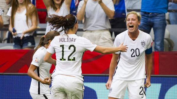 Abby Wambach of the U.S. (from right) celebrates with teammates Lauren Holiday and Tobin Heath after scoring against Nigeria at the end of the first half Tuesday during the FIFA Women's World Cup in Vancouver, Canada.