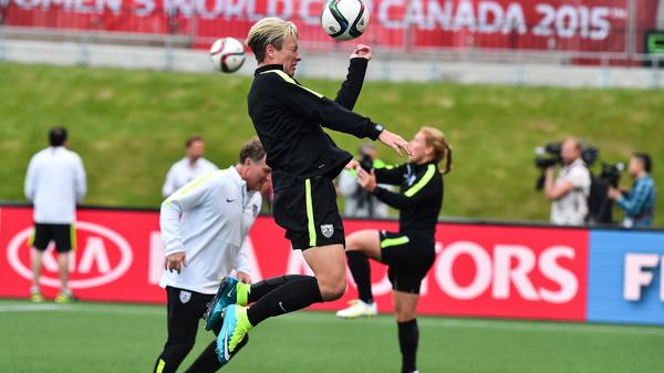 U.S. forward Abby Wambach and her teammates train for Friday's game against China in the Women's World Cup.