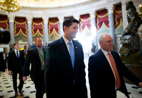 House Speaker Paul Ryan (center) walks to the House chamber ahead of a budget vote on Capitol Hill. Though Ryan was able to deliver 217 votes Thursday to get his GOP health plan through the House, there are still significant hurdles before the bill becomes law.