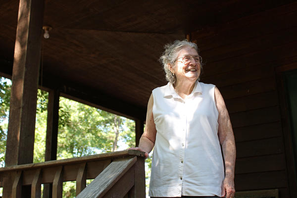 "Lulabelle Berry surveys the 600 acres she and her husband, Jimmy, own in the Ozarks near Mountain View, Ark. Berry walks laps on her porch to aid her recovery from a stroke. She says she's grateful for the drug that saved her life. ""It's been a good life,"" she says."